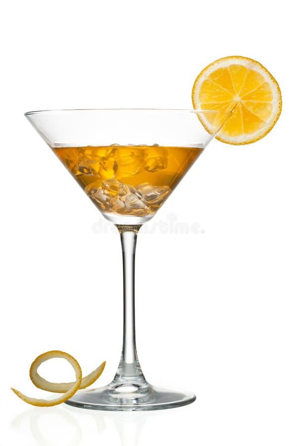 Jus d'orange dans martini photo stock