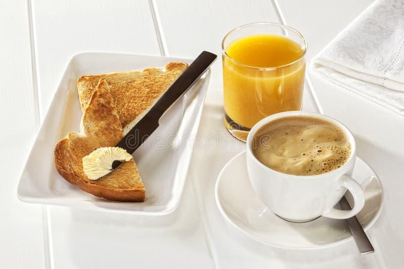 Jus d'orange de pain grillé de café image stock