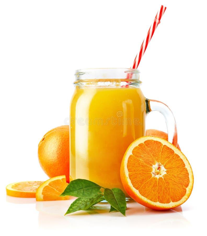 Jus d'orange frais avec le fruit et le vert photo libre de droits