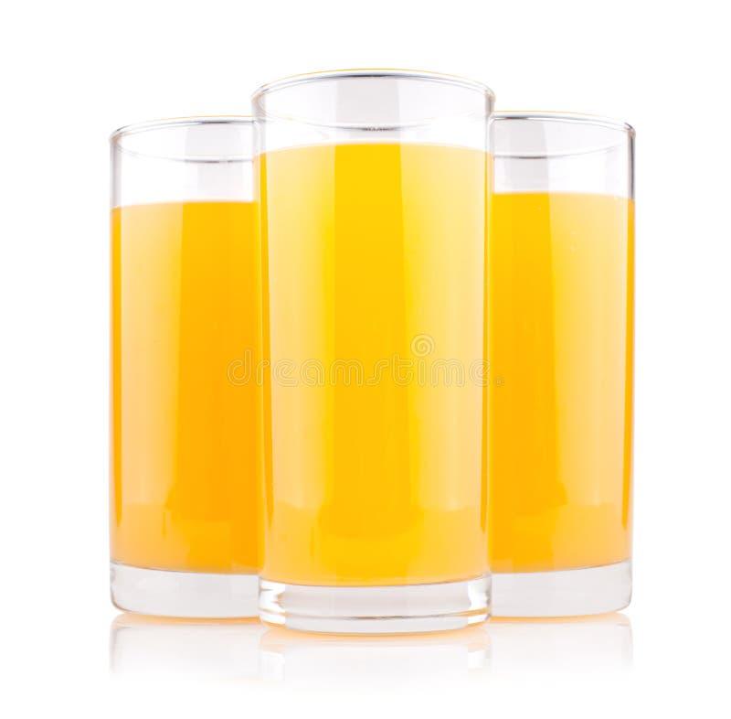 Jus d'orange in glazen stock afbeeldingen