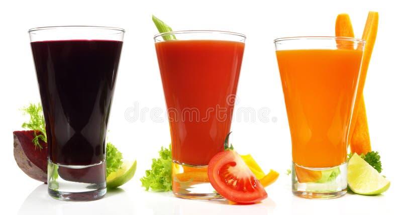 Jus de légumes sur le fond blanc - panorama photo stock