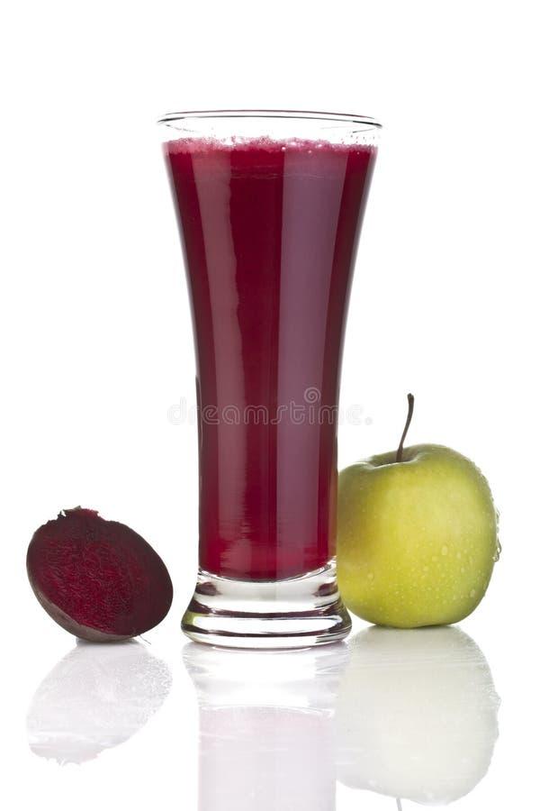 Jus de pommes frais et de betteraves images libres de droits