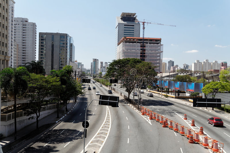 Juscelino Kubitschek Avenue. Juscelino Kubitschek, a large avenue in Sao Paulo in an uncommon quiet traffic day. A big construction in the back, some business stock image