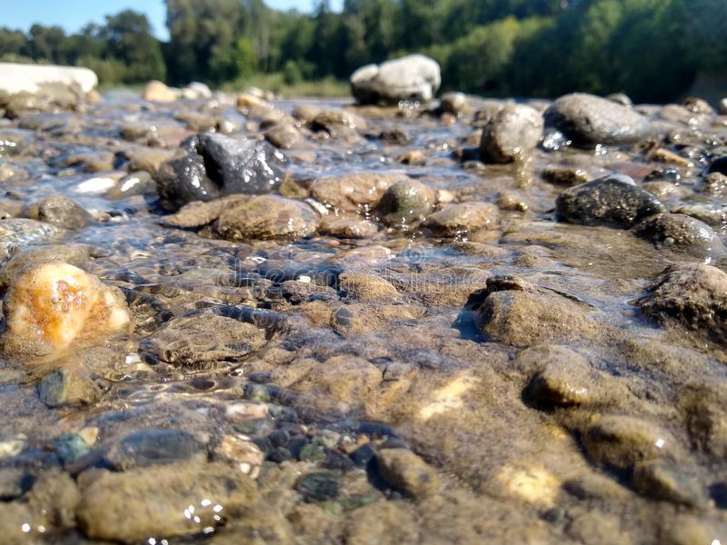 Just around the river bend. Water, pebbles royalty free stock photos