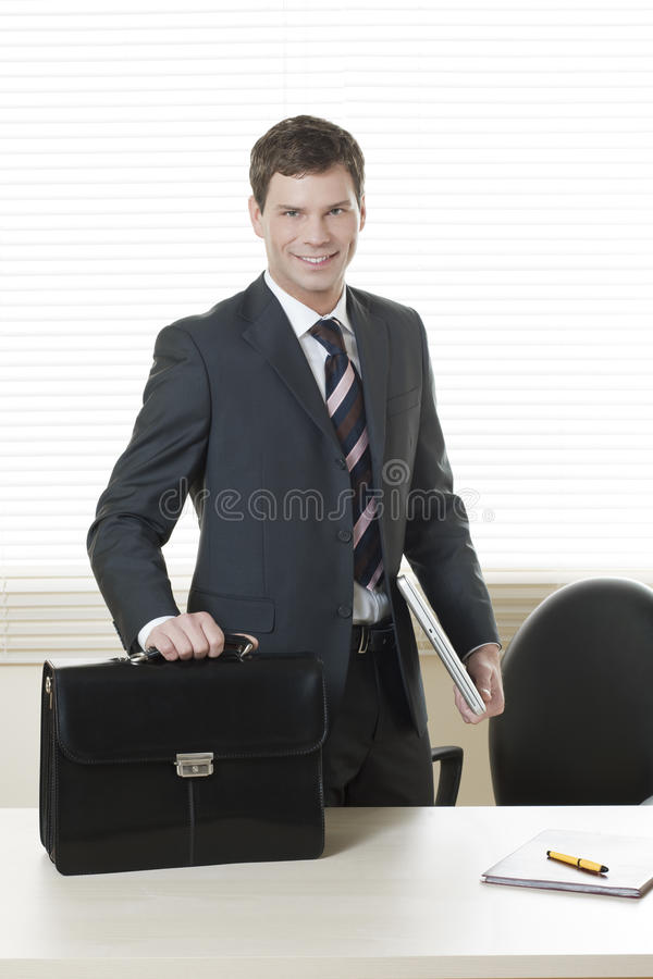 Just arrived in the office/Ready to go home stock images
