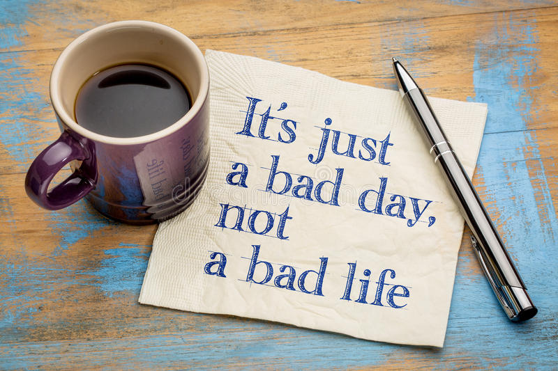 It is just a bad day, not ... It is just a bad day, not a bad life - handwriting on a napkin with a cup of espresso coffee stock image