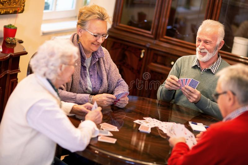 Just a friendly card game between old friends stock photo