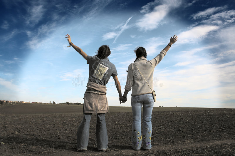 Just a friends?. Two teenagers in a fild under the autumn sky royalty free stock images