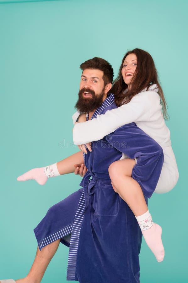 Just having fun. funny romantinc couple in love. Perfect funny morning. Having fun. woman and bearded man in robe. Happy stock photo
