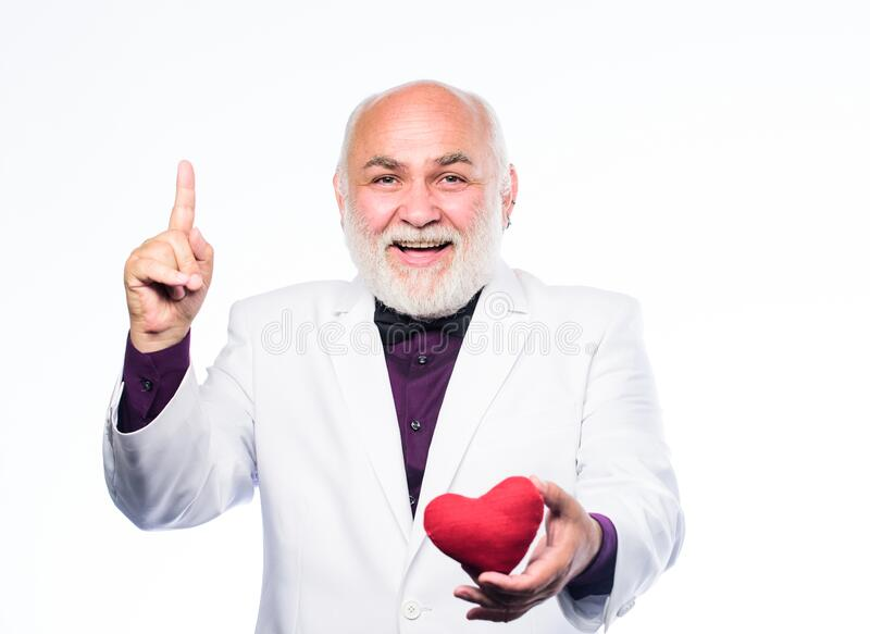 Just inspired. valentines day. donor transplant. happy mature man hold red heart. love and romance. bearded businessman royalty free stock image