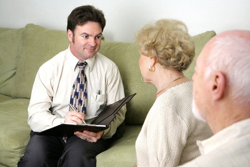 Just Listening. A marriage counselor or salesman listening to an elderly couple. Could also be a salesman