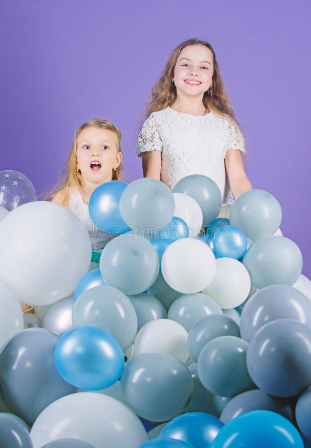 Just live it out to the fullest and have fun. Happy sisters enjoy birthday celebration. Little girls celebrating. Birthday with air balloons. Small children royalty free stock images