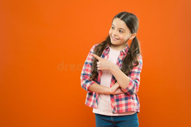 Just look at this. Product presentation. Kid happy face show something copy space. Girl demonstrate product. Commercial. Advertisement. Promotion concept royalty free stock images