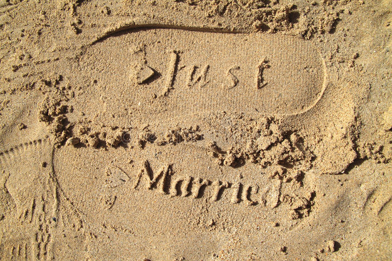 Just married. Imprint in beach sand royalty free stock photo