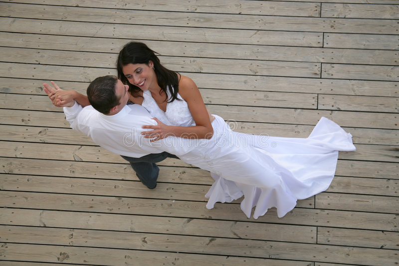 Just Married - bride and groom dancing. Their opening dance stock photography