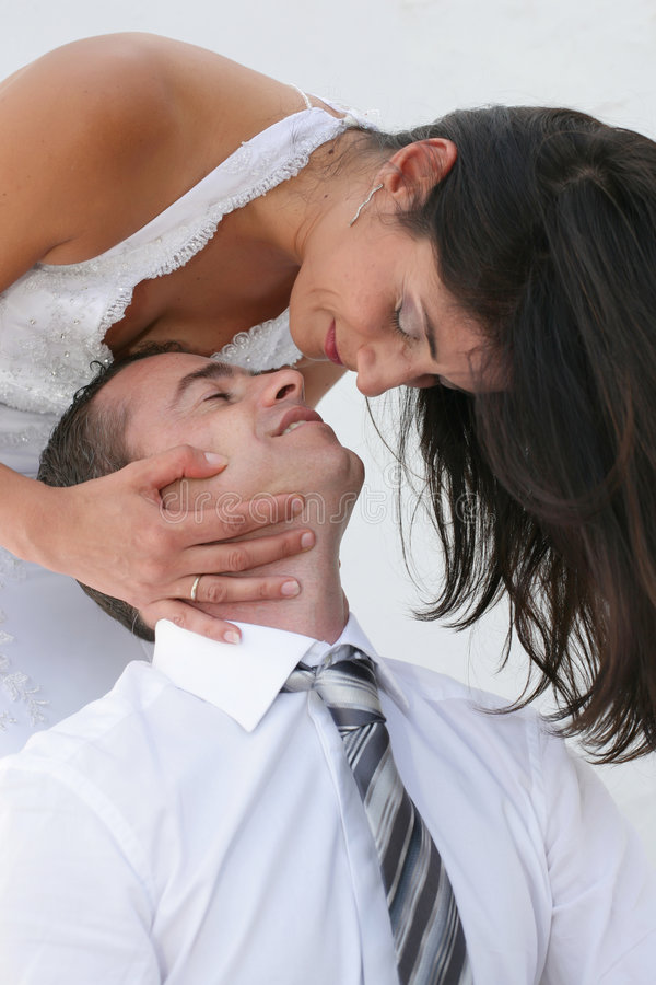 Just Married - bride and groom just about to kiss. Beautiful bride and groom just about to kiss royalty free stock photos