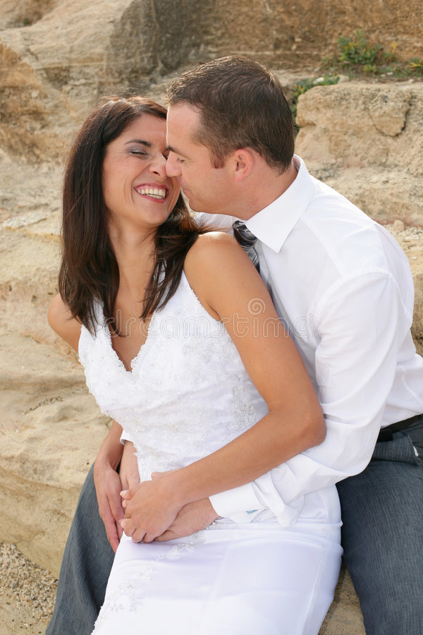 Just Married - bride and groom just about to kiss. Beautiful bride and groom just about to kiss royalty free stock photo