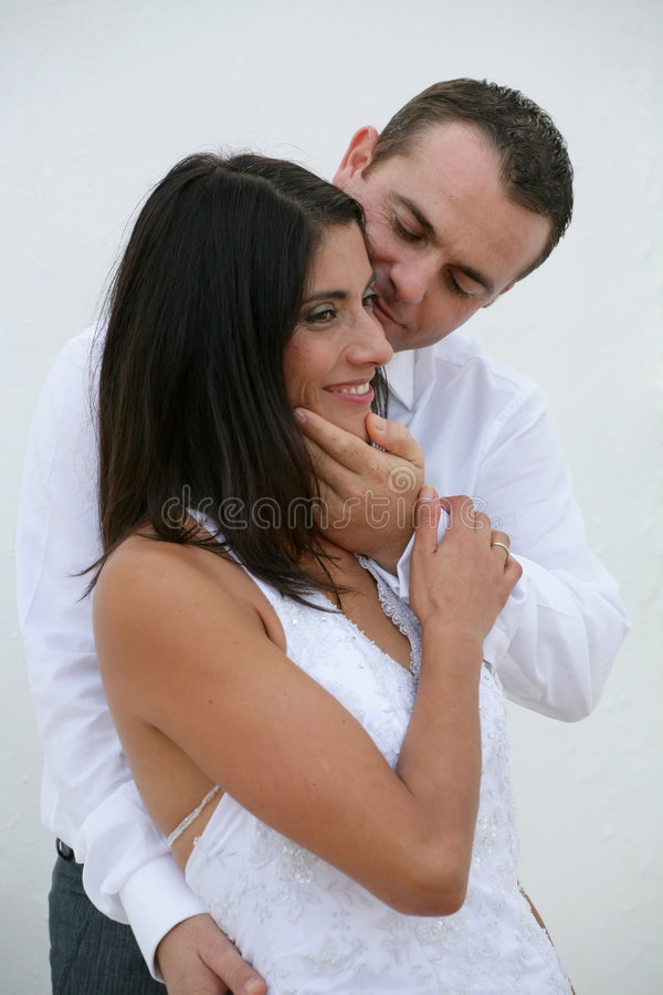 Just Married - bride in groom's arms. Beautiful bride in groom's arms royalty free stock image