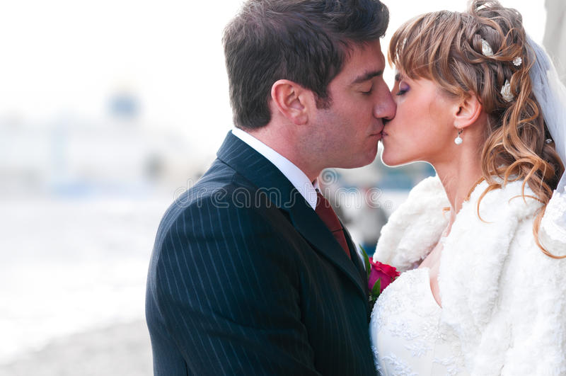 Just married couple. Is kissing at street stock photo