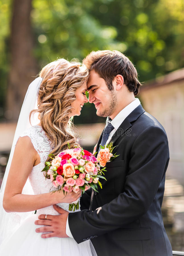 Just married couple embraced. Wedding couple, bride and groom stock image