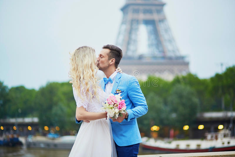 Just married couple near the Eiffel tower in Paris. Just married couple near the Eiffel tower on their wedding day. Bride and groom in Paris, France stock images