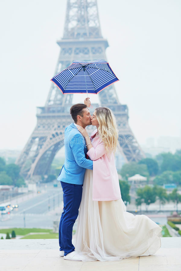 Just married couple near the Eiffel tower in Paris stock images