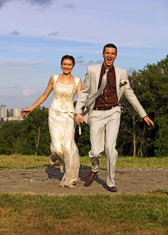 Download Just Married Couple Running In The Park Stock Photo - Image: 16077312