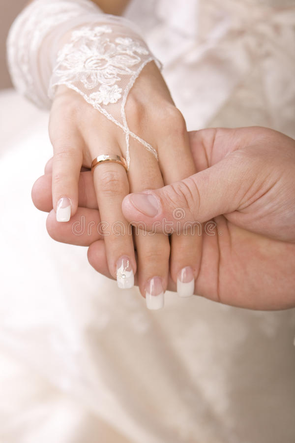 Download Just Married Couple Showing Up Their Rings Stock Image - Image: 16960457