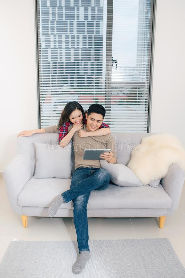 Just married couple of young man and woman feeling unbelievable chilling in their new house stock image
