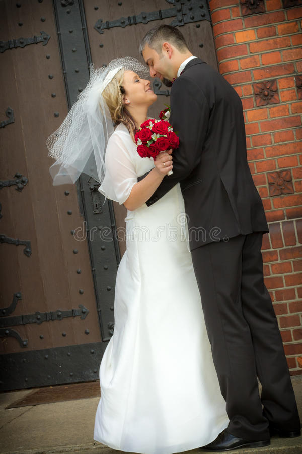 Just married in front of the church royalty free stock images