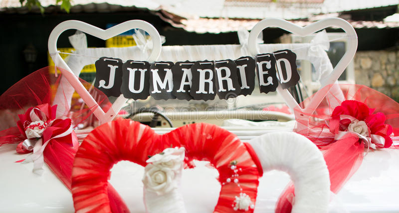 Just married note hanging from the car seat. Just married note hanging from the wedding car seat royalty free stock photography