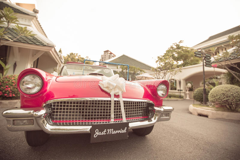 Just married sign with vintage wedding car royalty free stock photography