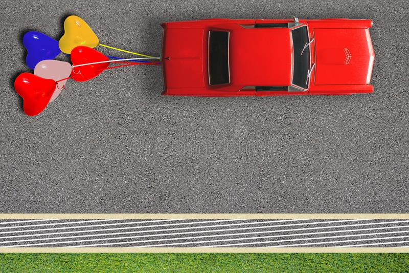 Just married wedding honeymoon concept poster card. Top view of red classic car and tied balloons. Copy space on road  surface stock photography