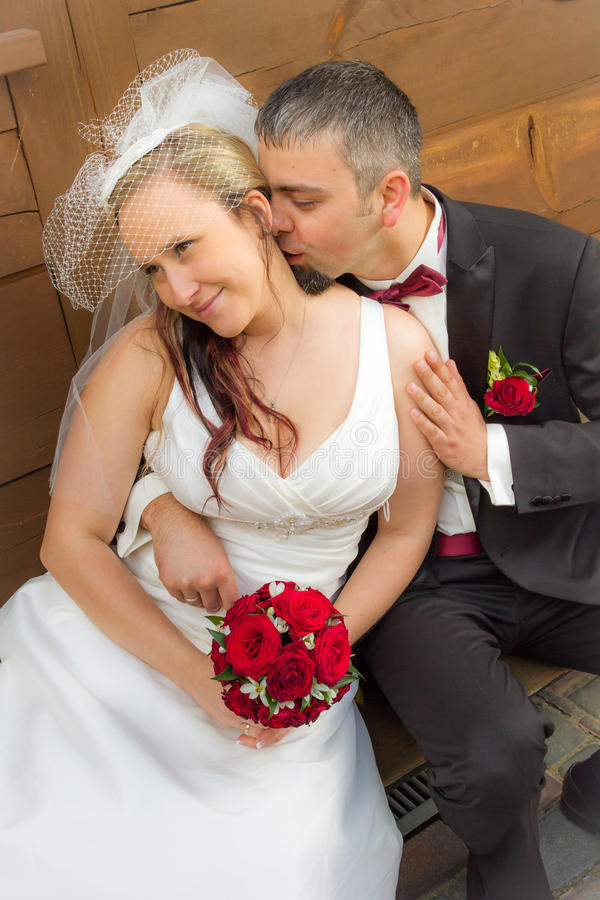 Just married young couple sitting on the porch stock image
