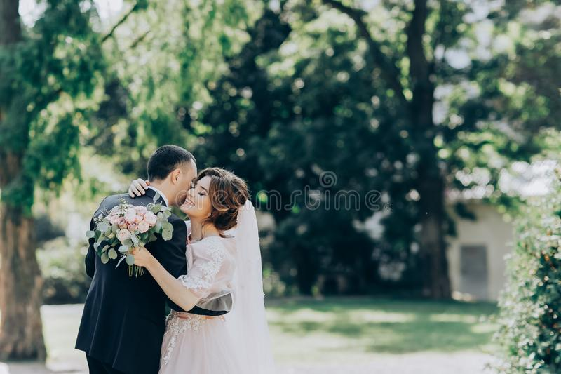 Just married, young wedding couple in a park, walking, savoring the moment royalty free stock photography