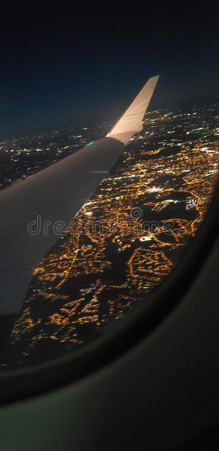 Just a peek. Just peek airplane lights night royalty free stock photography
