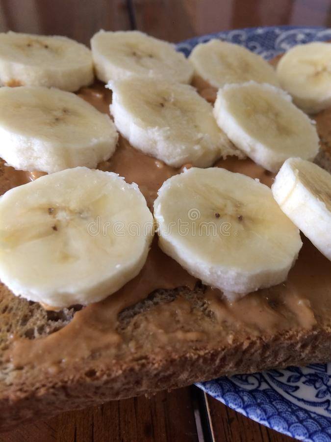 Peanut butter and bananas on toast royalty free stock photos