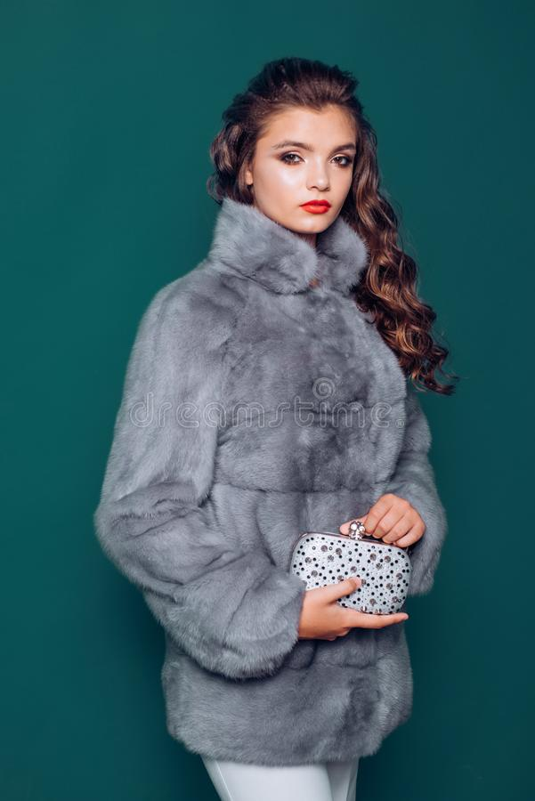 Just the posh side of fashion. Winter fashion trends. Young woman wear elegant winter coat. Pretty woman in fashionable. Fur coat. Fashion model wear luxurious stock photography