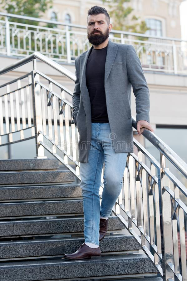 Just professional enough. Business man. Bearded man stand on stairs. Man wear business casual attire outdoor. Unshaven stock image