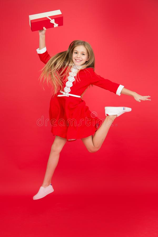 Just received birthday gift. Spread happiness and joy. Little child in motion jump. Delivery christmas present. Gifts stock images