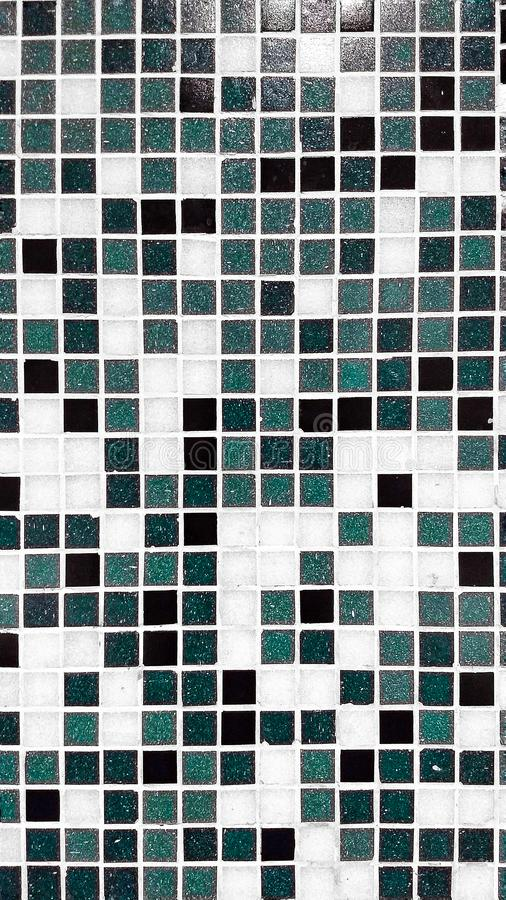 Texture and patterns. Just simple texture on a wall with the square patterns and variable block of different colour is making it worth watching and its stock photos