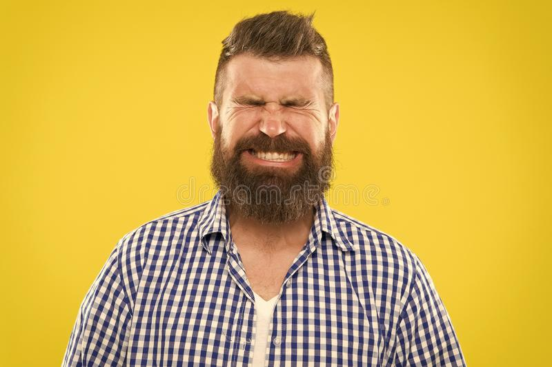 Just sneezed. Man bearded hipster with sneezing face closed eyes close up yellow background. Brutal hipster sneezing stock photos