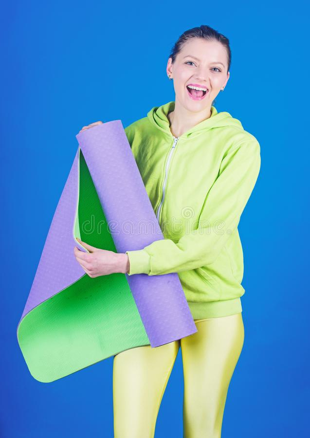 Just start. Strong muscles and power. Happy woman workout with fitness mat. Sporty woman training in gym. Sport mat. Equipment. Athletic fitness. Health diet stock photo