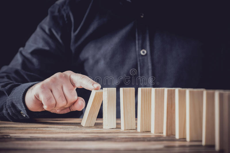 Just Starting Or Letting Domino Toppling Effect. Financial Chai royalty free stock photos