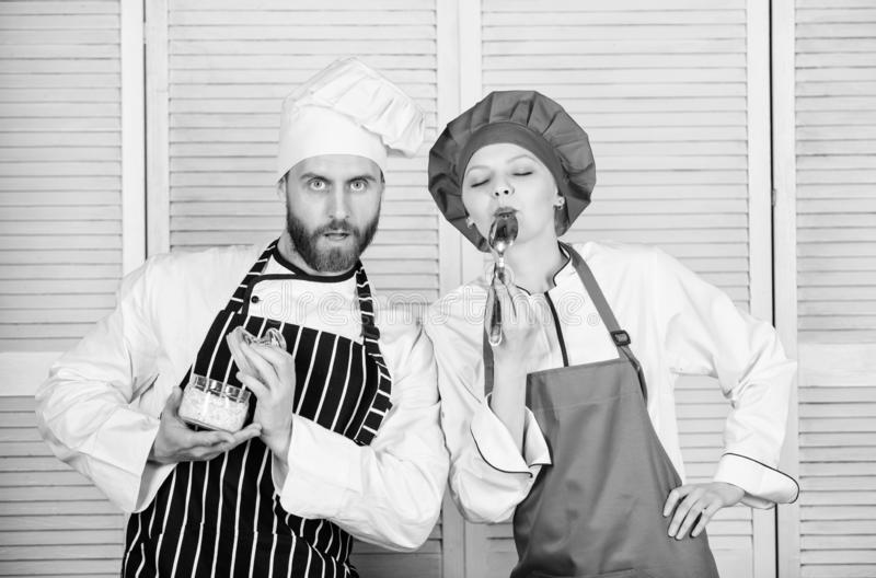 Just try this. Delicious meal. Woman and bearded man cooking together. Try ingredients before cook. Estimate taste royalty free stock photo