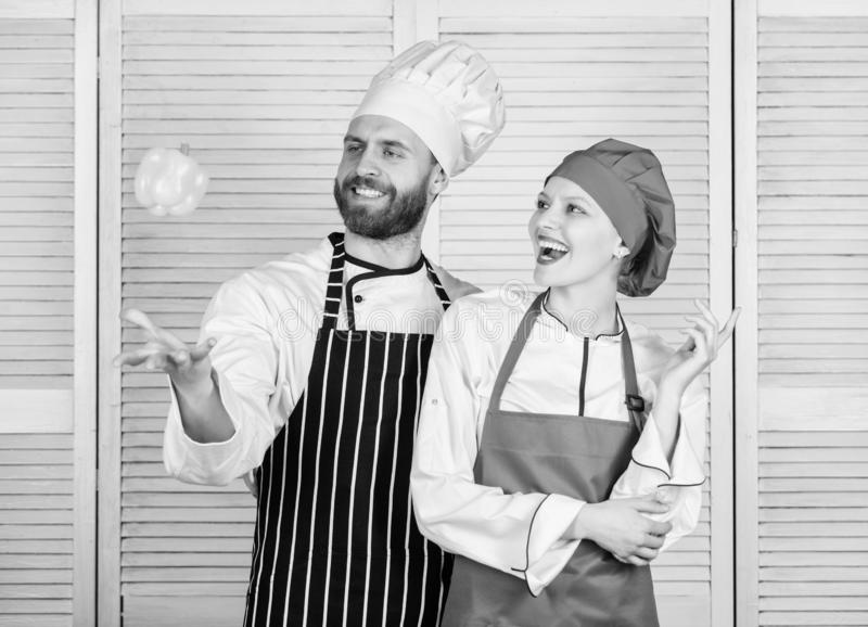Just try. Woman and bearded man cooking together. Cooking healthy food. Fresh vegetarian healthy food recipe. Fresh royalty free stock photo