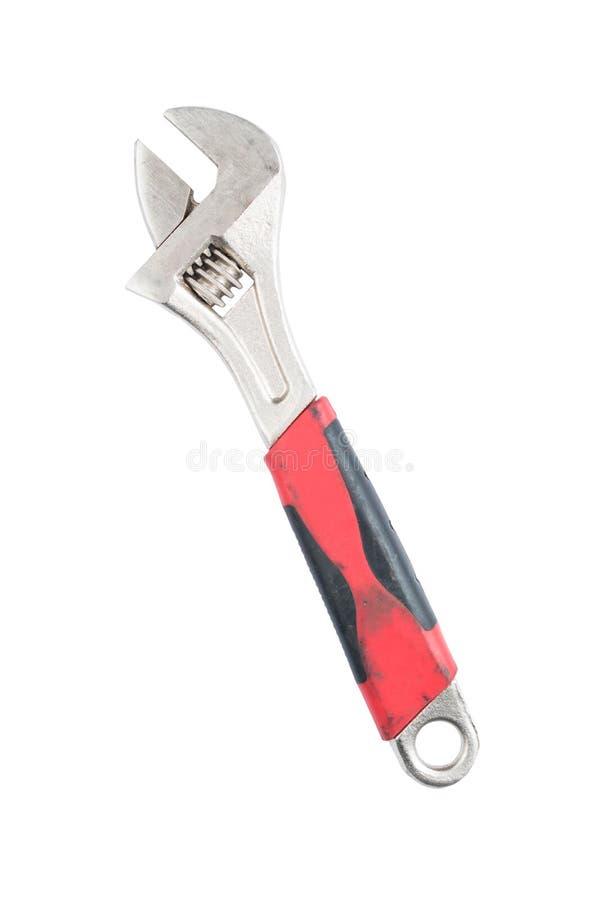 Justerbar skiftnyckel med det röda handtaget som isoleras på en vit bakgrund sparad bana plankor för blyertspenna för mått för li royaltyfria foton