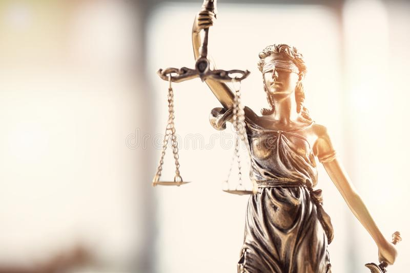 Justice blindfolded lady holding scales and sword statue royalty free stock photo