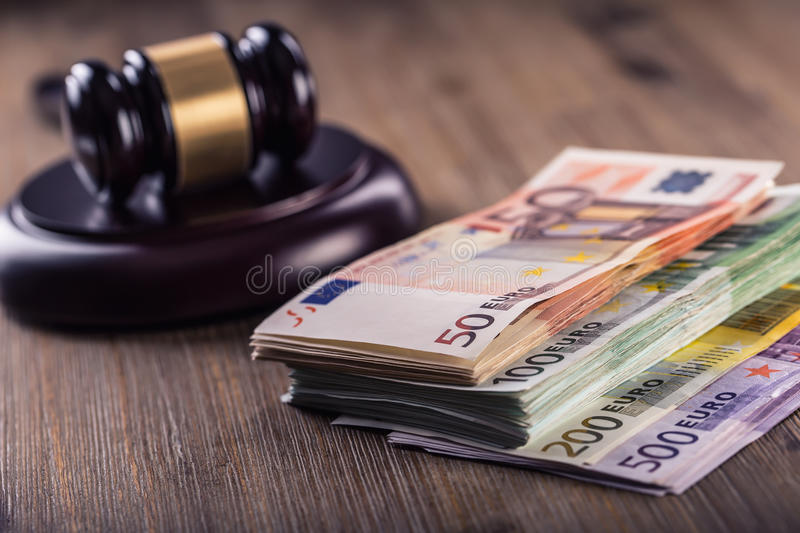 Justice and euro money. Euro currency. Court gavel and rolled Euro banknotes. Representation of corruption and bribery in the judi. Judge's hammer gavel. Justice stock images