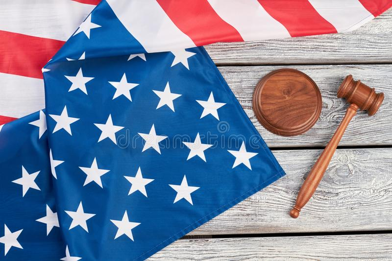 Justice gavel and American flag, top view. royalty free stock photo